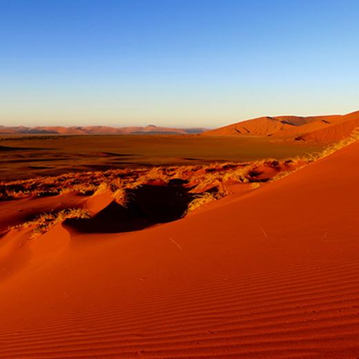 Sonnenaufgang in der Namib-Wüste
